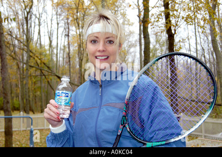 Female After Working Out at Tennis - Stock Photo