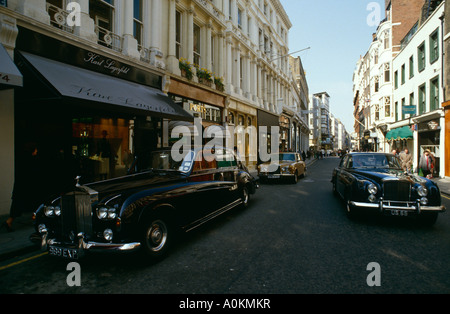 New Bond Street in London. Home of luxury shops such as Karl Lagerfield with Rolls Royce and Bentley cars parked - Stock Photo