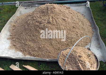 preparing cement with sand  - Stock Photo