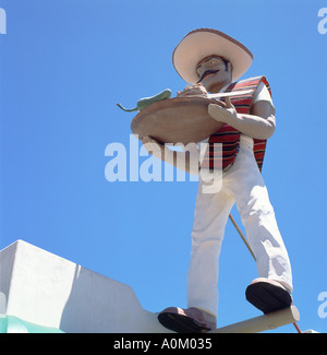 A Mexican statue of waiter with sombrero holding platter of food restaurant in  Los Angeles, California, USA  KATHY - Stock Photo