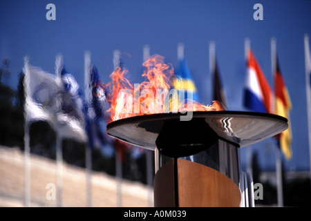 The Olympic Flame outside the newly restored old olympic stadium in Athens  - Stock Photo