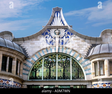 Close up of Art Nouveau gable and stained glass window above the entrance to the Royal Arcade shopping centre, Norwich. - Stock Photo