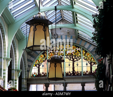 Art Nouveau lamp shades and stained glass window inside the Royal Arcade, Norwich city centre, Norfolk. - Stock Photo