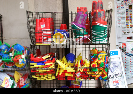 Buckets and spades on sale at seaside resort - Stock Photo