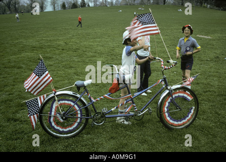decorated biycycle flags bunting children park Memorial Day 4th of July Labor Day Loyalty day parade - Stock Photo