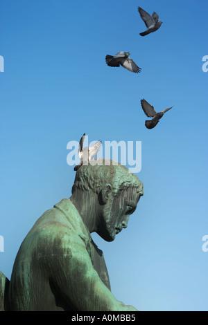 Statue by Wäinö Aaltonen of a Finnish author Aleksis Kivi in front of the National Theatre, Helsinki, Finland - Stock Photo