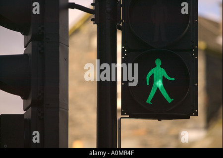 pedestrian crossing with green man walk sign - Stock Photo