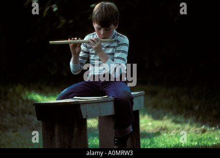 1 one young boy practices music old fashioned wood wooden hand carved flute history historical Landis Valley Farm - Stock Photo