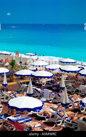 One of many private beaches by Promenade des Anglais in Nice on the French Riviera which requires an entrance fee - Stock Photo
