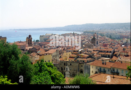 View over Nice the beach by Promenade des Anglais and the bay Baie des Anges from Parc du Château in Nice France - Stock Photo