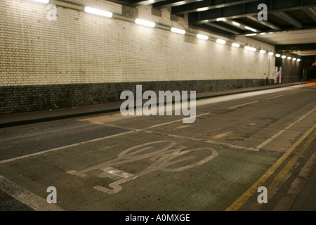 Road Tunnel in Birmingham with a cycle lane - Stock Photo
