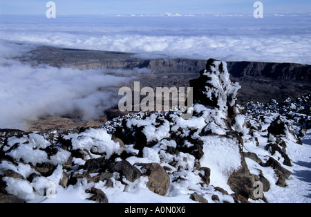 Ice covered lava rocks at Pico del Teide mount in Teide National Park Tenerife Canary Islands Spain - Stock Photo