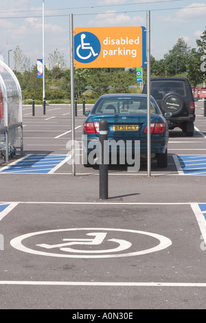 Disabled parking bay at Gallions Reach Shopping park Beckton Newham East London - Stock Photo