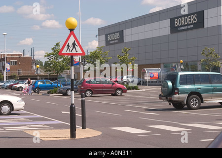 Belisha beacon and crossing sign at Gallions Reach Shopping Park Beckton Newham East London - Stock Photo