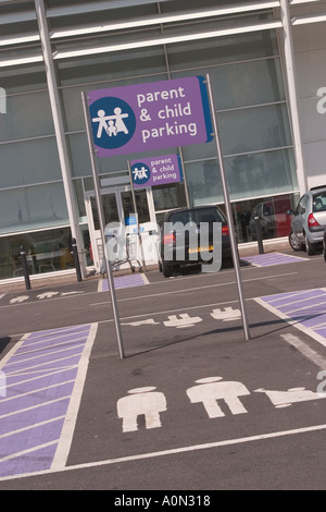 Parent and child parking bay at Gallions Reach Shopping park Beckton East London - Stock Photo