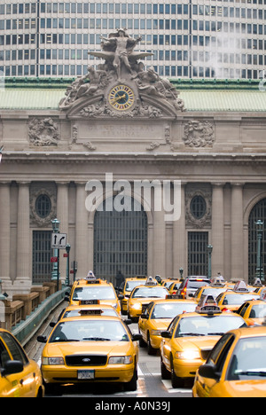 Yellow taxi cabs infront of Grand Central Station Midtown Manhattan New York USA - Stock Photo