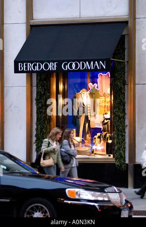 Shoppers pass Christmas window display Bergdorf Goodman mens department store 5th Avenue Uptown Manhattan New York - Stock Photo