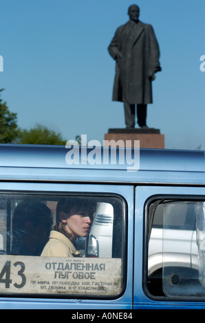 A statue of Lenin watches over traffic in Yuzhno Sakhalinsk on Sakhalin Island in Russia 2004 - Stock Photo