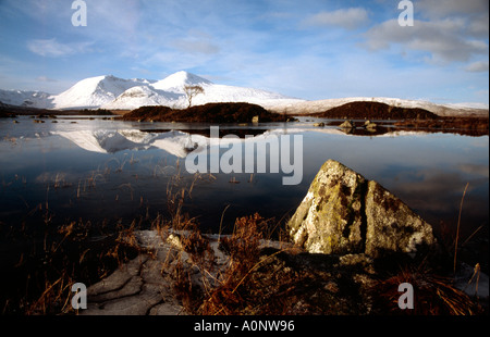 Lochan na h Achlaise, Meall a Bhuiridh and the Black Mount covered in snow, Rannoch Moor, Lochaber, Highland, Scotland - Stock Photo