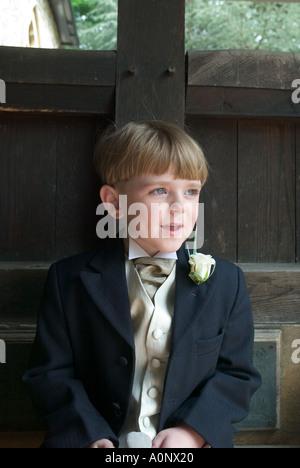 Boy in wedding suit - Stock Photo