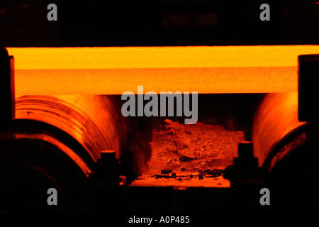 Roller conveyor with hot strip steel in the Hot Strip Mill at Corus Port Talbot steelworks Wales UK - Stock Photo