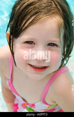 Little girl on side of pool - Stock Photo