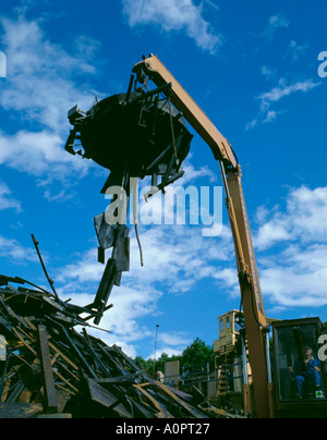 Electromagnet in use in a scrap metal yard; Newcastle upon Tyne, Tyne and Wear, England, UK. - Stock Photo