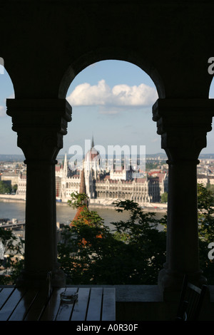 Parliament building seen through an arch in Budapest Hungary - Stock Photo