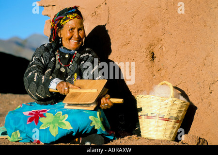 Berber woman in traditional clothing carding wool Telouet near Ouarzazate Morocco North Africa Africa - Stock Photo