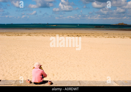 A girl near the beach Plage de l Ecluse Dinard Brittany France Europe - Stock Photo