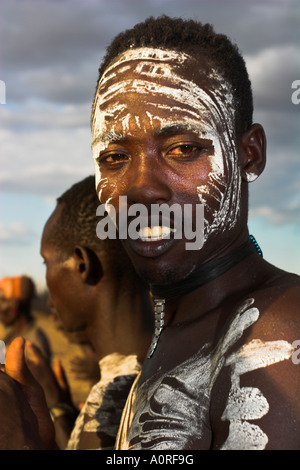 Karo man with body painting made from mixing animal pigments with clay at dancing performance Kolcho village Lower - Stock Photo