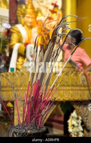Burning incense Shwedagon Paya Yangon Rangoon Myanmar Burma Asia - Stock Photo