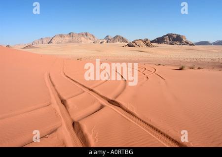 Car tracks in the sand desert scenery Wadi Rum Jordan Middle East - Stock Photo
