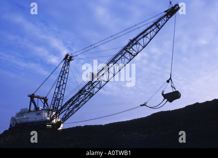 enormous electric dragline shovel at Texas open pit lignite coal mine - Stock Photo