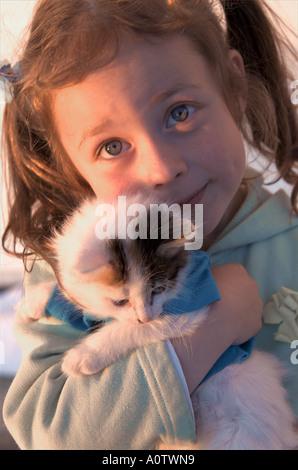 little girl and her kitten - Stock Photo