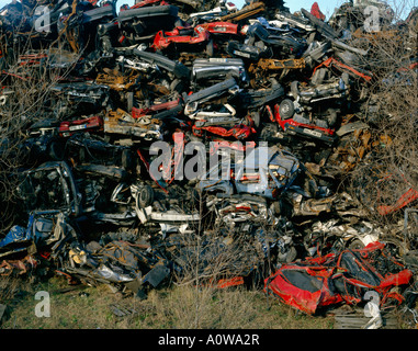 trashed cars in a heap - Stock Photo