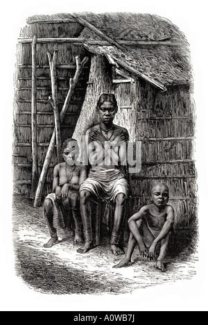 bakalai woman children Africa Gabon Gaboon Djembe Omboue rush reed hut house home wood thatch sit sat pose native - Stock Photo