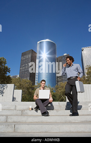 Two businessmen on steps - Stock Photo