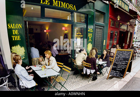 PARIS France, Groups of Women Sharing Lunch on Sidewalk Terrace of Local  Bistro 'Le Mimosa' Tea Room (now closed) - Stock Photo