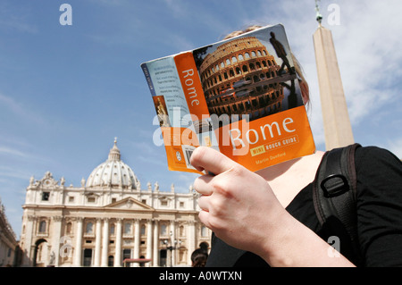 Italy Roma Rome St Peters Square Young woman reading Rome guide book - Stock Photo