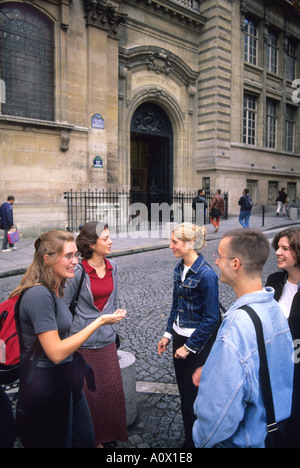 French college students outside the Sorbonne in Paris France  - Stock Photo