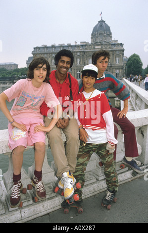 Ethnic diverse group of teenagers hanging out in Paris France  - Stock Photo