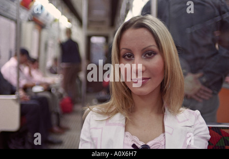 UK ENGLAND LONDON Lithuanian girl commuting to work on the underground train (tube) - Stock Photo