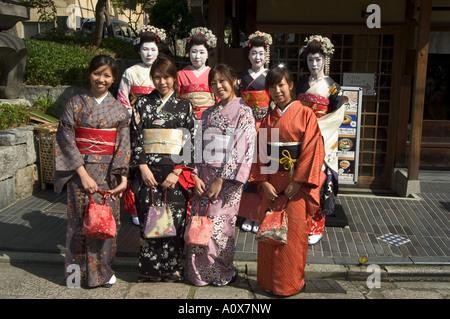 Girls wearing yukata kimono geisha maiko trainee geisha in Gion Kyoto city Honshu Japan Asia - Stock Photo