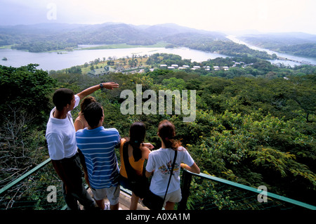 Tourists looking at panorama from canopy tower Soberania Forest National Park Gamboa Panama Central America - Stock Photo