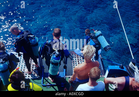 Scuba divers getting ready to jump off a dive boat Bodrum Mugla Turkey - Stock Photo