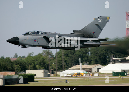 RAF Tornado GR4 flies low over runway on afterburner RIAT 2005 RAF Fairford Gloucestershire England UK - Stock Photo