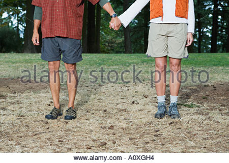 Hikers holding hands - Stock Photo