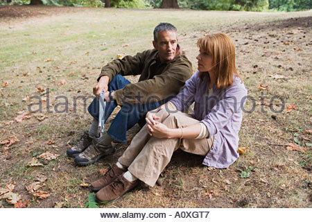 Couple sitting on the ground - Stock Photo