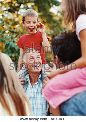 Children on adult shoulders - Stock Photo